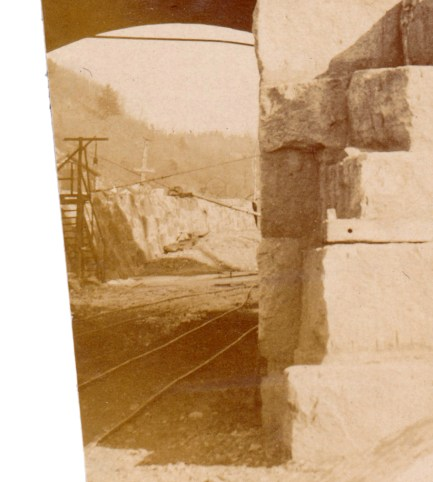 Detail showing the railroad tracks through the tunnel, used to bring stone to the face of the dam