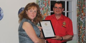 George Moss of Crowborough CFR receiving their award from Rotary President Helen Marshall