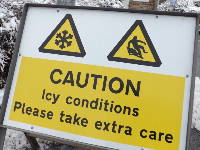 """Caution Icy Conditions """"Please take extra care"""" sign"""