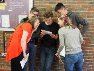 Louis Kemp (centre) top performing students at Beacon Academy Crowborough