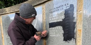 new names of fallen in World War I being added to the Crowborough War Memorial