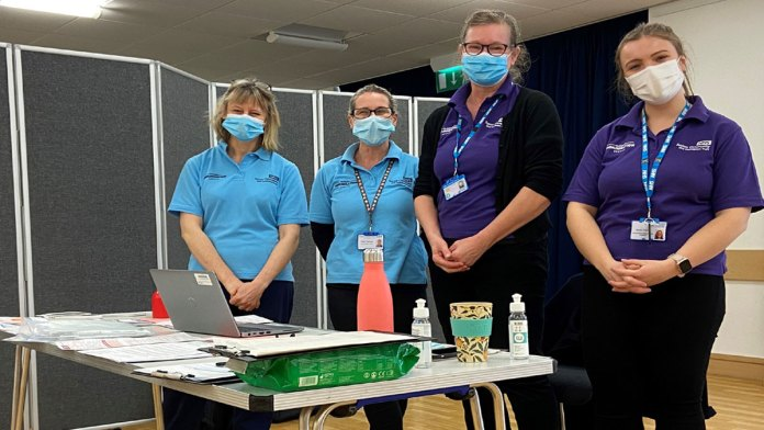 Photo showing nurses setting up the first children's vaccination clinic at Crowborough Community Centre.