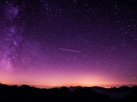 meteor falling on purple sky