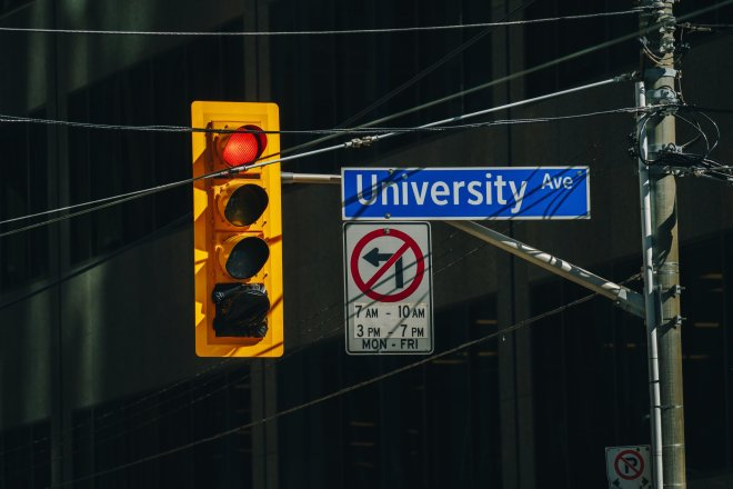 Red connotation traffic light and sign