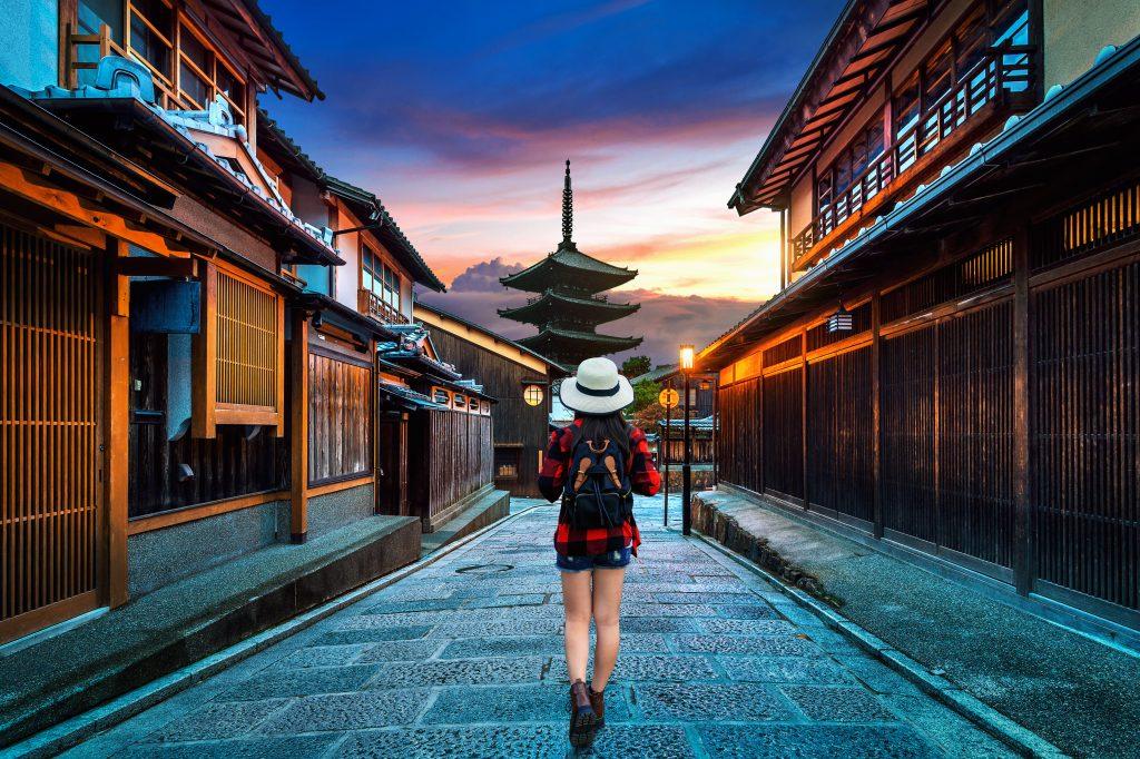 woman traveler with backpack walking yasaka pagoda sannen zaka street kyoto japan 1024x682 1