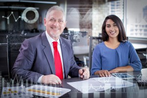 Portrait Of Smiling Experienced Mentor And Young Female Employee