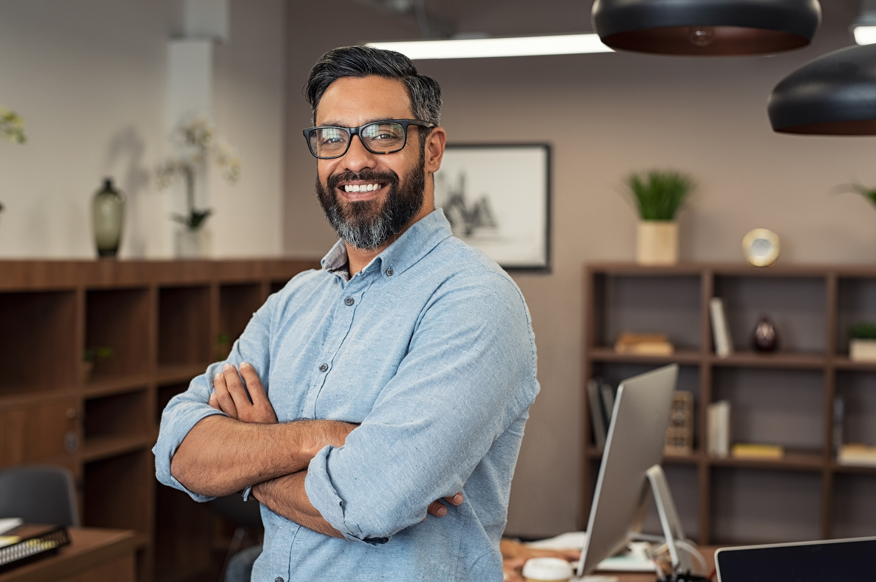 Happy mature businessman wearing spectacles