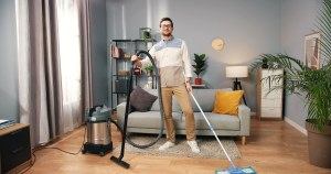 Handsome busy serious man cleaning