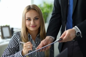 Woman signs full list services indicating cost