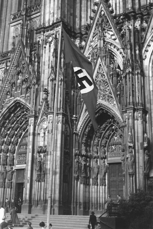 Flag flying in front of Cologne Cathedral, 1937