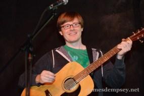 Jonathan Penn with an acoustic guitar