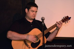 Nathan Eror playing guitar