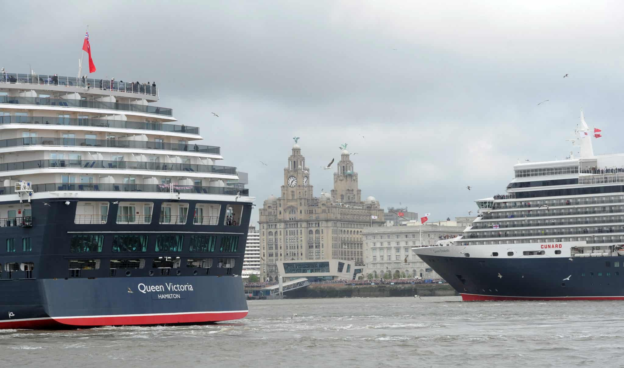 Cunard 175th celebrations on the River Mersey, Liverpool pictured The Three Queens cruise liners Queen Victoria and Queen Elizabeth on the river. Photo by Colin Lane