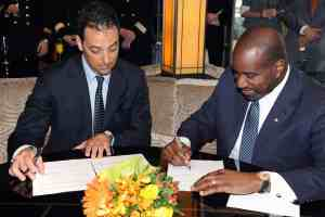 Fincantieri Shipyard Director Antonio Quintano and Orlando Ashford, president, Holland America Line sign papers for delivery of ms Koningsdam.