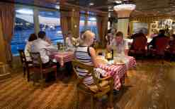 Guests aboard Carnival Magic enjoy the Cucina del Capitano restaurant that offers family-style Italian dining. Photo by Andy Newman/Carnival Cruise Lines