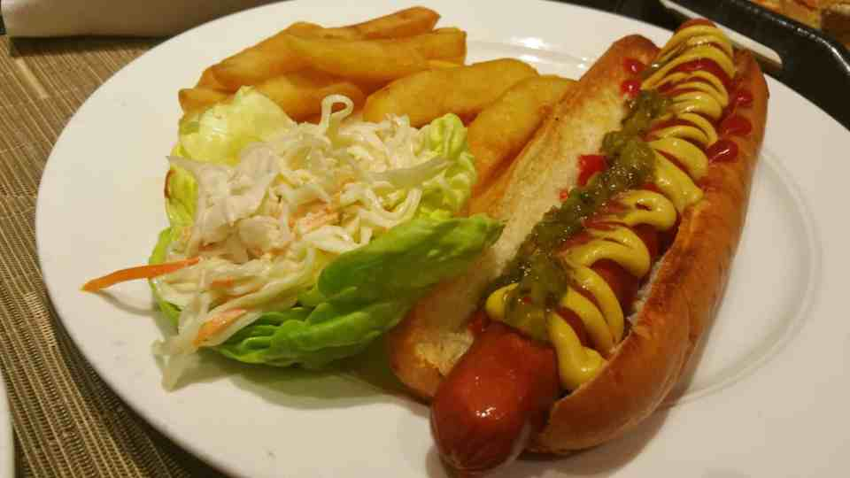 Drive-In classic hot dog with mustard, ketchup, onions, and relish.