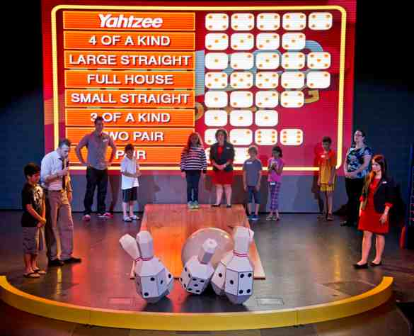 A Carnival Sunshine vacationer plays Yahtzee Bowling, part of Hasbro, The Game Show, an audience participation activity featuring larger-than-life adaptations of the companyÕs iconic board games. (Andy Newman/Carnival Cruise Lines)