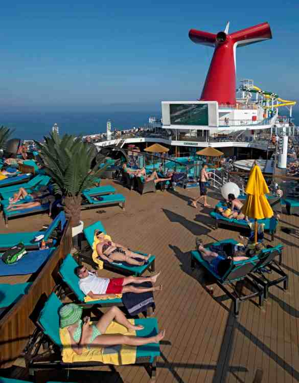 Carnival Sunshine is the lineÕs first ship to feature a three-level Serenity adults-only retreat, which offers a pool, whirlpool, comfortable chaise lounges and chairs, colorful umbrellas and, of course, magnificent sea views. (Andy Newman/Carnival Cruise Lines)