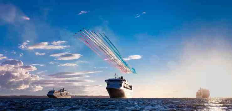 The RAF Red Arrows display team fly over Cunard's three Queens