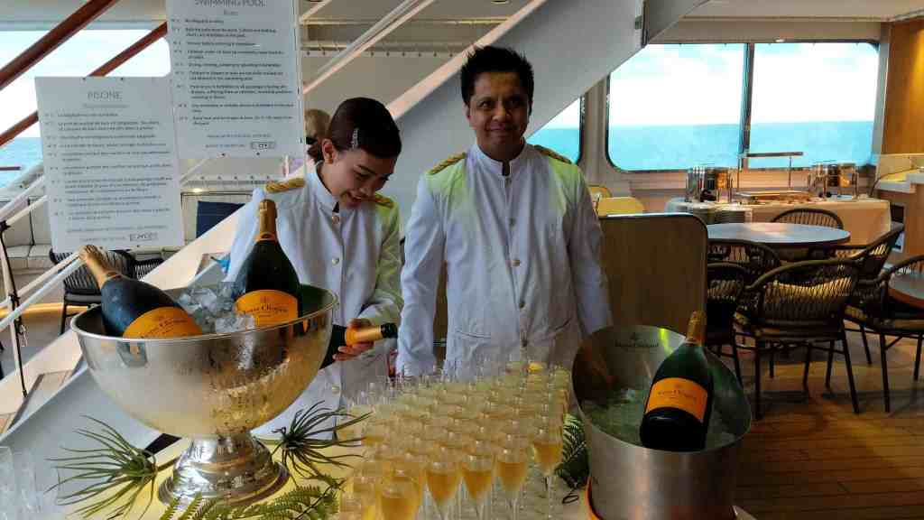 Champagne toast on Le Laperouse