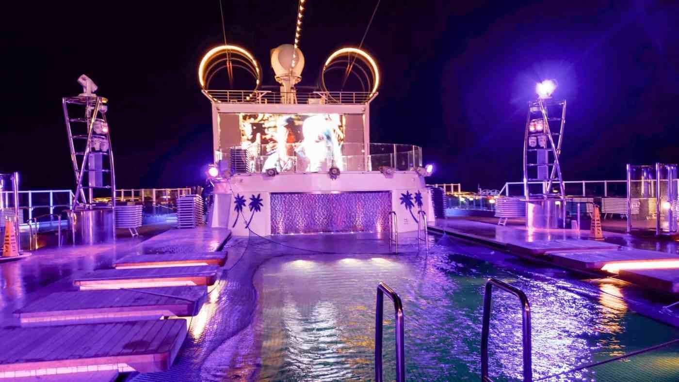 The beautiful main pool at night aboard MSC Seaside