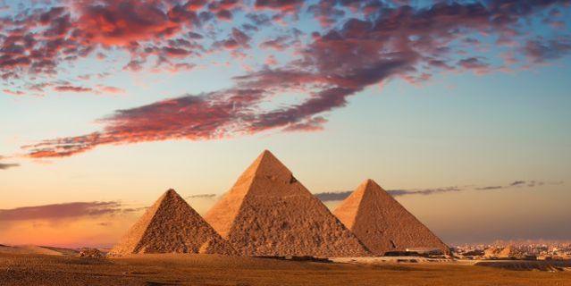 sunset at the pyramids giza cairo egypt royalty free image 1588090066
