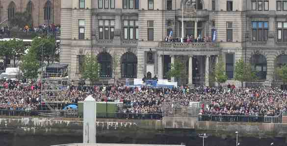 The crowds at the Pier Head waiting for Queen Elizabeth, Queen Victoria and Queen Mary in the river Mersey  to celebrate the 175th anniversary of Cunard