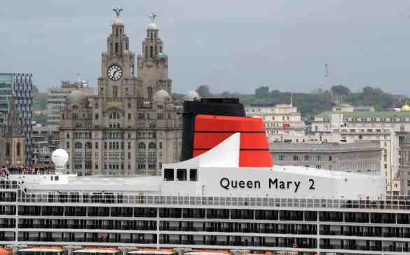 Queen Mary in the river Mersey with the backdrop of the city to celebrate the 175th anniversary of Cunard