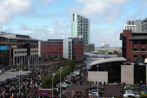 Crowds flock to the Liverpool waterfront to watch the three queens, Queen Elizabeth, Queen Mary 2 and Queen Victoria perform a river dance together during  Cunard's 175 years celebrations. Queen Mary 2 disappears down the Mersey to her next destination. VT