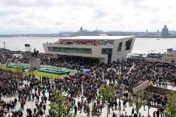 Crowds flock to the Liverpool waterfront to watch the three queens, Queen Elizabeth, Queen Mary 2 and Queen Victoria perform a river dance together during  Cunard's 175 years celebrations. VT