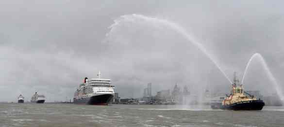 Cunard 175th celebrations on the River Mersey, Liverpool pictured The Three Queens cruise liners Queen Elizabeth, Queen Victoria and Queen Mary 2 as the pass the waterfront.  Photo by Colin Lane