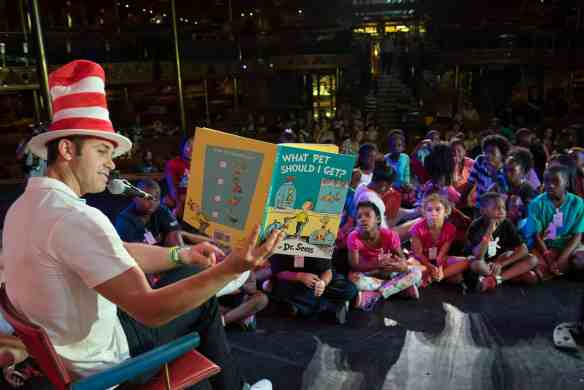 "Tampa Bay Rays all-star Evan Longoria reads the new Dr. Suess book ""What Pet Should I Get?"" to children aboard Carnival Paradise"