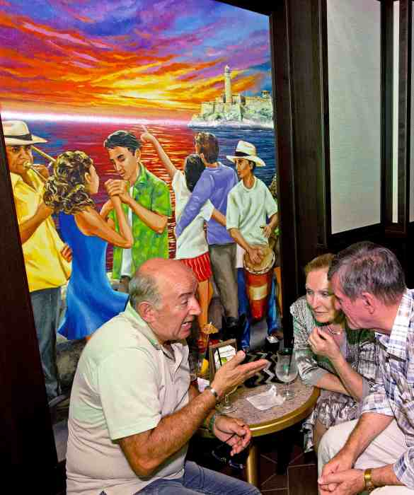 Guests converse in Havana Bar aboard the Carnival Vista. The largest and most innovative cruise vessel in Carnival Cruise Line's fleet, Carnival Vista measures 133,500 tons, 1,055 feet long and has a guest capacity of almost 4,000 passengers. Photo by Andy Newman/Carnival Cruise Line