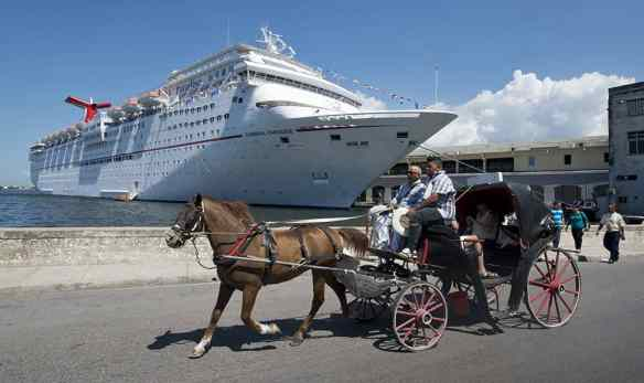 A horse-drawn carriage passes the Carnival Paradise while the cruise ship is docked in Havana, Cuba. (Andy Newman/Carnival Cruise Line)