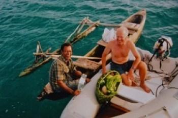 Dinghy as fender when trading fruit for fish hooks