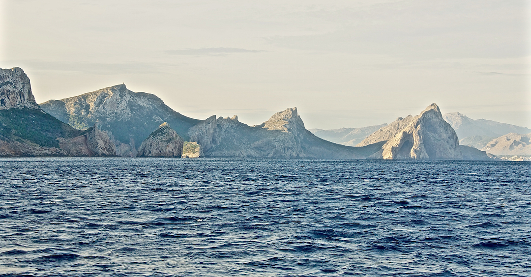 Rocky, mountainous north coast of Mallorca. Cruising Attitude Sailing Blog - Discovery 55