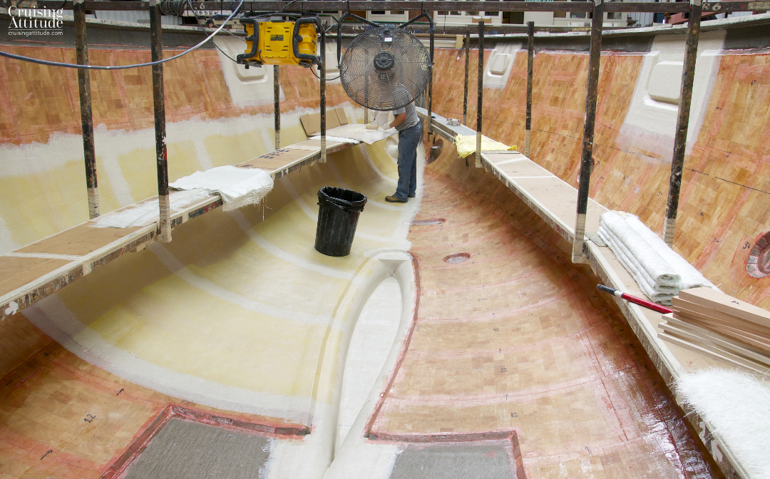 Kevlar layers going into the mould | Cruising Attitude Sailing Blog - Discovery 55