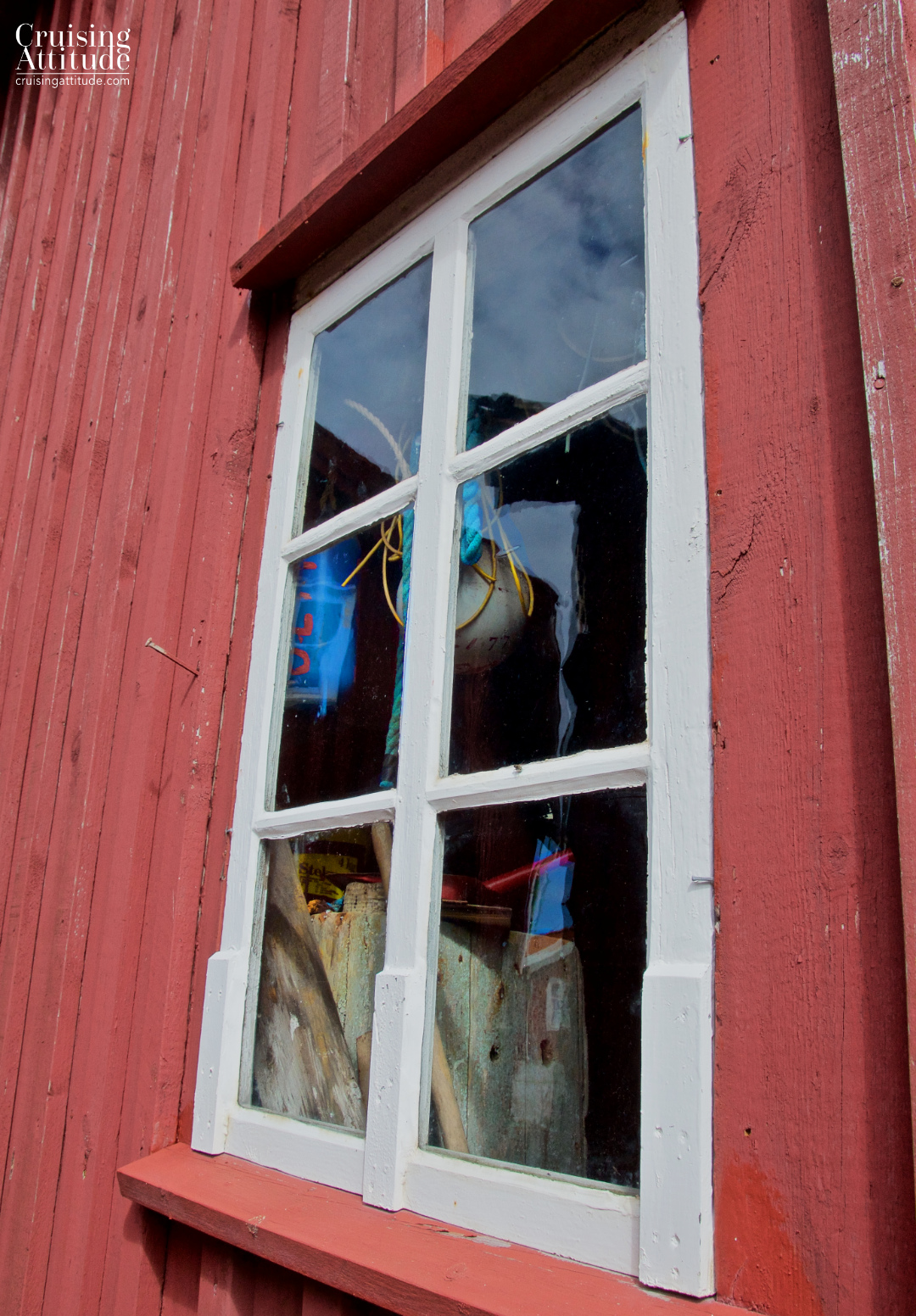 Looking into the window of a fishing cabin. Mollösund, Sweden | Cruising Attitude Sailing Blog - Discovery 55