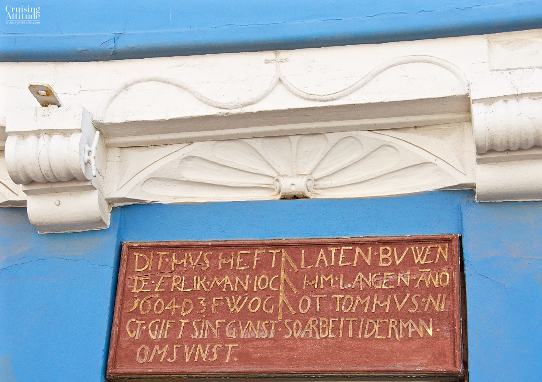 An inscription written in old Danish over a door in Helsingør, Denmark | Cruising Attitude Sailing Blog - Discovery 55