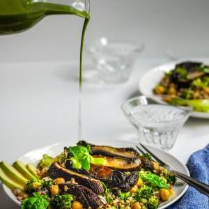 Lemon Basil Dressing being poured over portobello broccoli chickpea grain salad