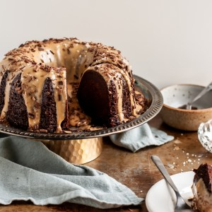 Vegan Chocolate Bundt Cake with Salted Peanut Butter Glaze sliced and being served