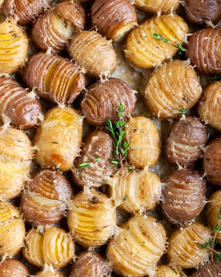 Vegan Garlic and Thyme Scalloped Hasselback Baby Potatoes close up