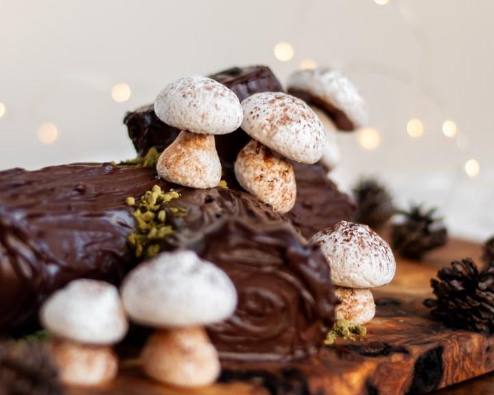 Vegan Meringue Mushrooms on a Vegan Chocolate Yule Log