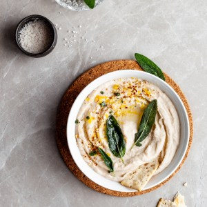 Lemon Sage White Bean Dip garnished with fried sage leaves