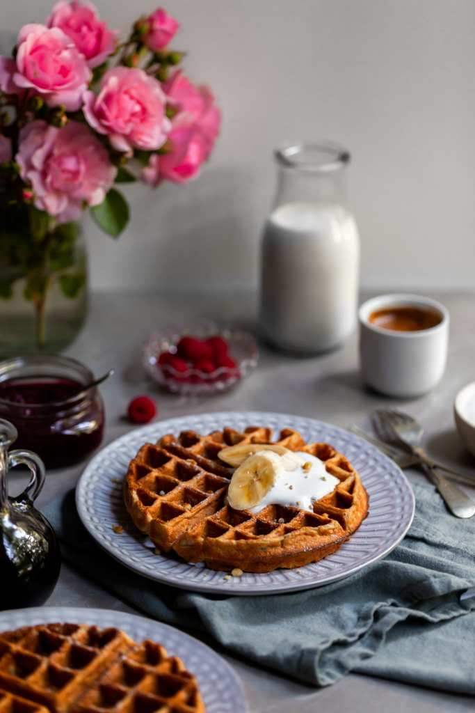 Vegan Banana Waffles served with vegan cream and fresh bananas