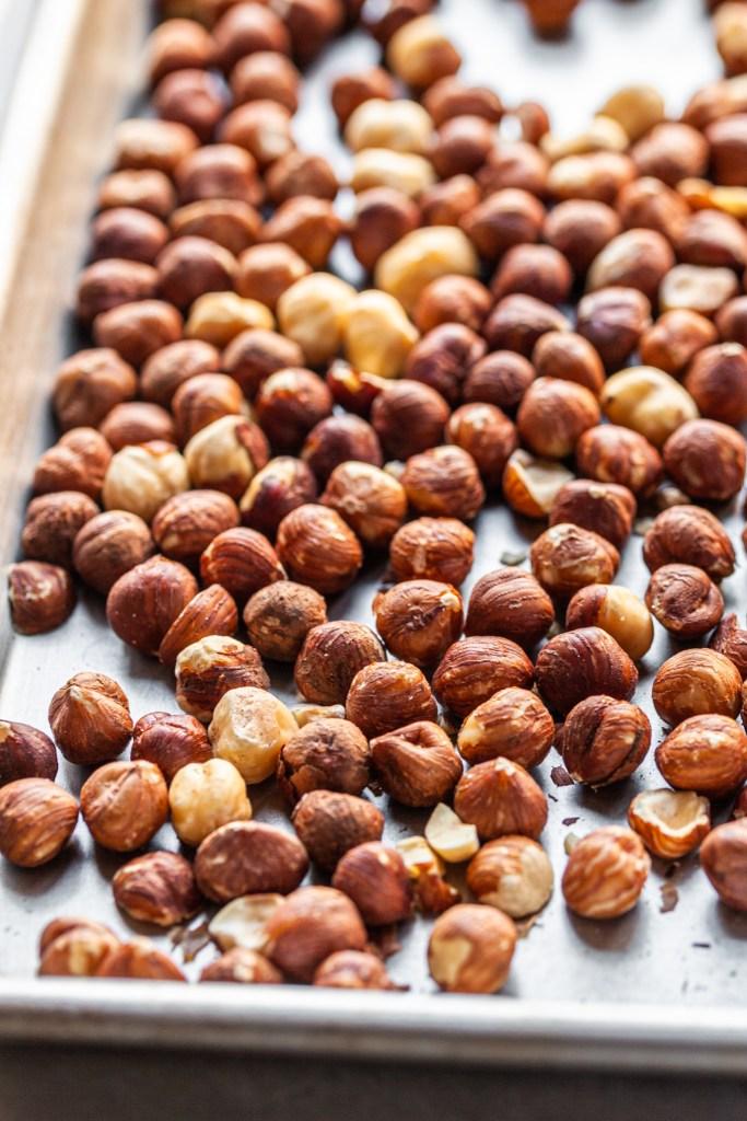 Whole hazlenuts on a baking sheet