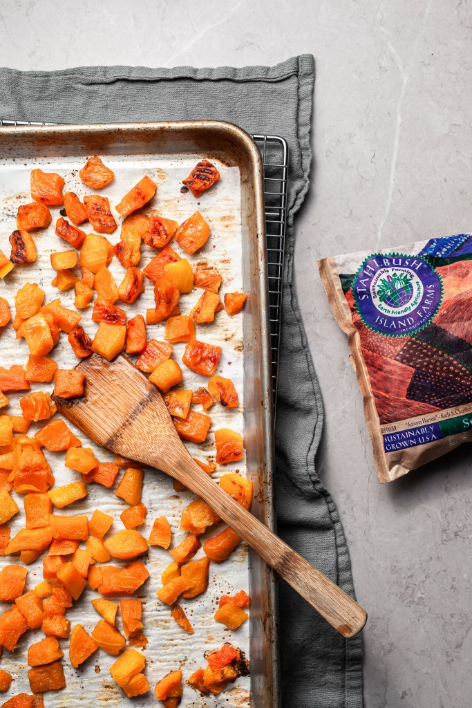 A baking sheet covered in roasted butternut squash