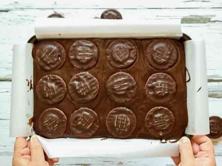 Brownie mix in a tray topped with Jaffa Cake biscuits