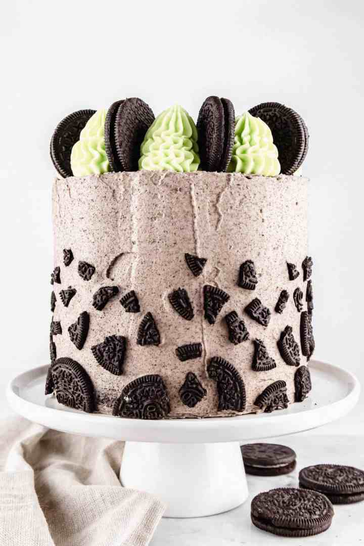 Mint Oreo cake on a white cake stand