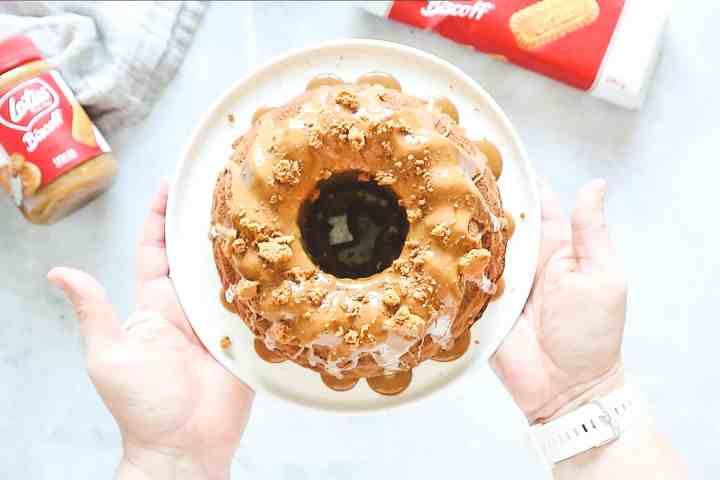 Biscoff Bundt cake on a white cake stand